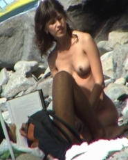Lovely lady plays with her tits in public
