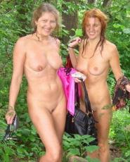 Beautiful ladies having naked fun outdoors