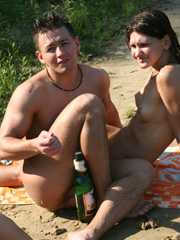 Nudists at the beach drinking and having lots of fun